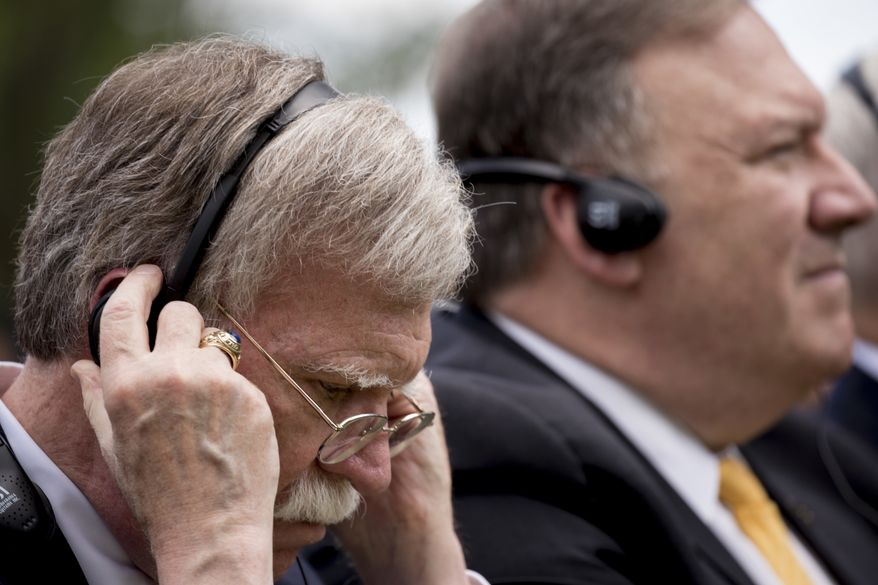 National Security Adviser John Bolton, left, and Secretary of State Mike Pompeo, right, attend a news conference between President Donald Trump and Japanese Prime Minister Shinzo Abe in the Rose Garden at the White House, Thursday, June 7, 2018, in Washington. (AP Photo/Andrew Harnik)