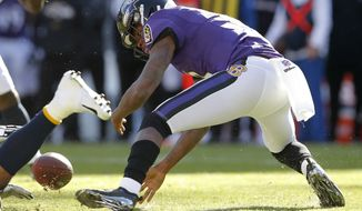 Baltimore Ravens quarterback Lamar Jackson recovers a fumble that he made in the first half of an NFL wild card playoff football game against the Los Angeles Chargers, Sunday, Jan. 6, 2019, in Baltimore. (AP Photo/Carolyn Kaster)