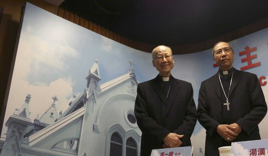 Retired head of the Catholic Diocese of Hong Kong Cardinal John Tong, left, and Bishop Joseph Ha, right, pose for photographers before a press conference in Hong Kong Monday, Jan. 7, 2019. Tong will serve as the church's interim administrator in the semi-autonomous Chinese territory, effectively blocking the succession of the highest-ranking serving bishop known to be critical of Beijing. Bishop Joseph Ha is widely seen as being too outspoken to be an acceptable successor. The announcement was made by the diocese Monday after Bishop Michael Yeung died on Thursday. (AP Photo)