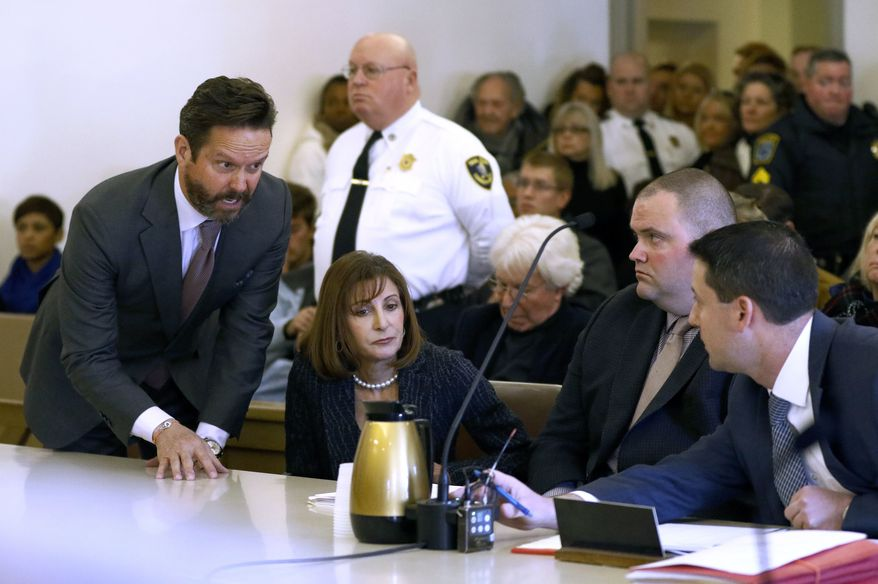 Attorneys for actor Kevin Spacey, Alan Jackson, left, and Juliane Balliro, second from left, confer with assistant district attorney Michael Giardino, far right, in district court during Spacey's arraignment on Monday, Jan. 7, 2019, in Nantucket, Mass. The Oscar-winning actor is accused of groping the teenage son of a former Boston TV anchor in 2016 in the crowded bar at the Club Car in Nantucket. (Nicole Harnishfeger/The Inquirer and Mirror via AP, Pool)