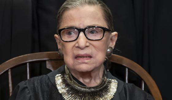 In this file photo from Friday, Nov. 30, 2018, Justice Ruth Bader Ginsburg sits during a formal group portrait, at the Supreme Court in Washington. Justice Ginsburg, 85, is missing arguments for the first time in more than 25 years as she recuperates from cancer surgery last month but is recuperating and working from home. (AP Photo/J. Scott Applewhite, file)