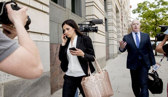 File - In this May 9, 2018 file photo, Attorneys Eric Dubelier, right, and Katherine Seikaly, left, representing Concord Management and Consulting LLC, walk out of federal court in Washington, after pleading not guilty on behalf of the company, which has been charged as part of a conspiracy to meddle in the 2016 US presidential election. A federal judge on Monday reprimanded Dubelier, saying his references to Looney Tunes and Animal House in recent court filings are inappropriate.   (AP Photo/Andrew Harnik)