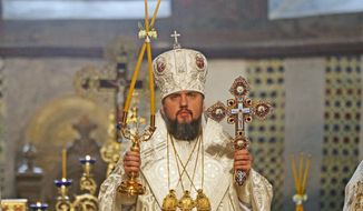 Metropolitan Epiphanius, the head of the independent Ukrainian Orthodox Church, conducts the Christmas service in the St. Sophia Cathedral in Kiev, Ukraine, Monday, Jan. 7, 2019. (AP Photo/Efrem Lukatsky)