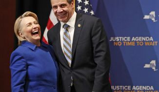 Former Secretary of State Hillary Clinton, left, reacts as she stands on stage with New York Governor Andrew Cuomo, Monday, Jan. 7, 2019, in New York, during a dual appearance at Barnard College where the pair called for codifying abortion rights into New York State law. (AP Photo/Kathy Willens)