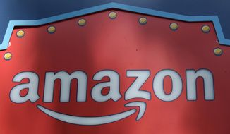 FILE - This Oct. 23, 2018, file photo shows an Amazon logo atop the Amazon Treasure Truck The Park DTLA office complex in downtown Los Angeles. Amazon has eclipsed Microsoft as the most valuable publicly traded company in the U.S. as a see-sawing stock market continues to reshuffle corporate America's pecking order. The shift occurred Monday, Jan. 7, 2019, after Amazon's shares rose 3 percent to close at $1,629.51 and lifted the e-commerce leader's market value to $797 billion. (AP Photo/Richard Vogel, File)