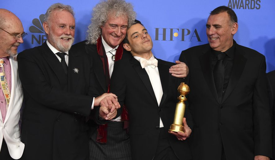 Jim Beach, from left, Roger Taylor, Brian May, Rami Malek and Graham King pose in the press room at the 76th annual Golden Globe Awards at the Beverly Hilton Hotel on Sunday, Jan. 6, 2019, in Beverly Hills, Calif. (Photo by Jordan Strauss/Invision/AP)
