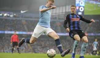 Manchester City's Kevin De Bruyne, left crosses the ball under pressure from Rotherham's Ben Wiles during the English FA Cup third round soccer match between Manchester City and Rotherham United at Etihad stadium in Manchester, England, Sunday, Jan. 6, 2019. (AP Photo/Rui Vieira)