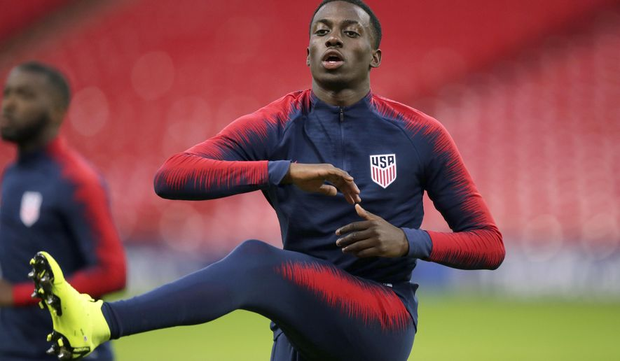 FILE - In this Wednesday, Nov. 14, 2018 file photo, United States national soccer team player Timothy Weah exercises during a training session at Wembley Stadium in London. Tim Weah, a striker for the U.S. national team and the son of former AC Milan star George Weah, has joined Scottish champion Celtic on a six-month loan deal from Paris Saint-Germain, Celtic announced on Monday Jan. 7, 2019. (AP Photo/Tim Ireland, File)