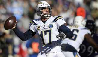 Los Angeles Chargers quarterback Philip Rivers throws a pass in the first half of an NFL wild card playoff football game against the Baltimore Ravens, Sunday, Jan. 6, 2019, in Baltimore. (AP Photo/Nick Wass)
