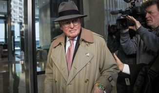FILE - In this Jan. 3, 2019, file photo, Chicago Alderman Ed Burke, 75, walks into the Dirksen Federal Courthouse in Chicago. The fallout is continuing for the longtime Chicago City Council member who charged with trying to shake down a fast-food chain _ and for politicians with connections to him. (Ashlee Rezin/Chicago Sun-Times via AP, File)/Chicago Sun-Times via AP)