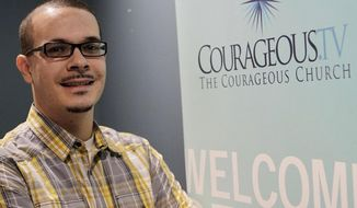 FILE - In this undated file photo, Shaun King poses where he was the lead pastor of Courageous Church in Midtown Atlanta. Acting on a tip received by civil rights activist King, the Harris County Sheriff's Office has made an arrest in the case of a 7-year-old girl who was killed in a drive-by shooting. (Vino Wong/Atlanta Journal-Constitution via AP, File)