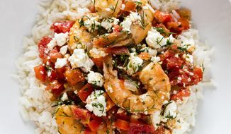 """This undated photo provided by America's Test Kitchen in December 2018 shows Greek-Style Shrimp with Tomatoes and Feta in Brookline, Mass. This recipe appears in the cookbook """"Complete Mediterranean."""" (Daniel J. van Ackere/America's Test Kitchen via AP)"""