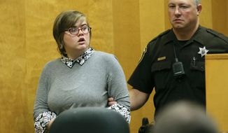 FILE - In this Sept. 29, 2017, file photo, Morgan Geyser, one of two Wisconsin girls charged with stabbing a classmate 19 times in 2014 to impress the fictitious horror character Slender Man, enters a Waukesha County Court for a status hearing in Waukesha, Wis. Geyser is appealing her case. The Journal Sentinel reports that Morgan Geyser's attorney recently filed a court brief arguing that Geyser shouldn't have been prosecuted as an adult because the girl believed Slender Man would kill her family if she didn't stab her sixth-grade classmate. (Michael Sears/Milwaukee Journal-Sentinel via AP, Pool, File)