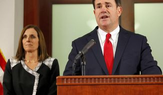 FILE - In this Dec. 18, 2018, file photo Arizona Gov. Doug Ducey speaks during a news conference at the Capitol in Phoenix. Ducey is starting a second term with inaugural festivities at the state Capitol, accompanied by five other newly elected top state officials who come from both leading political parties as Arizona takes on a purple tint. (AP Photo/Matt York, File)