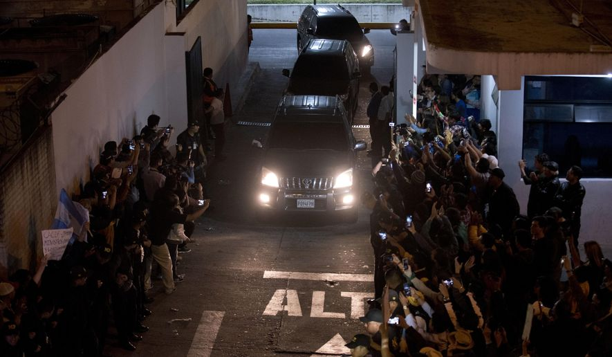 A caravan carrying Colombian national Yilen Osorio, a member of the International Commission Against Impunity in Guatemala (CICIG) leaves the La Aurora International Airport in Guatemala City, Sunday, Jan. 6, 2019. Authorities in Guatemala were holding Osorio, a member of the U.N.-sponsored anti-corruption commission in the capital's airport on Sunday, refusing him entry to the country in an escalation of tensions between the government and the commission. (AP Photo/Santiago Billy)