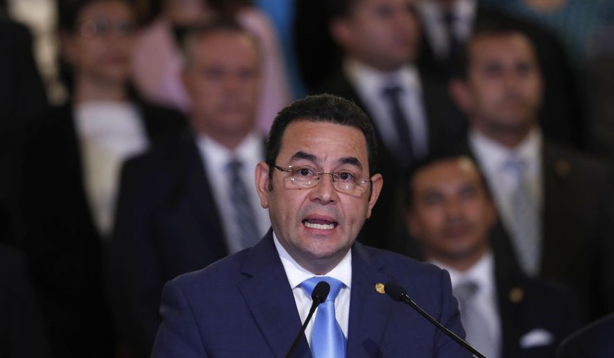 Guatemala's President Jimmy Morales, flanked by his cabinet, gives a statement at the National Palace in Guatemala City, Monday, Jan. 7, 2019. Guatemala announced that it is going to withdraw from UN-sponsored anti-corruption commission. (AP Photo/Moises Castillo)