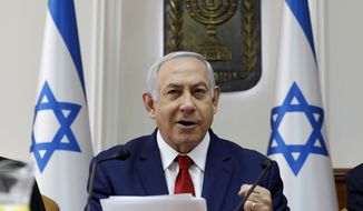 Israeli Prime Minister Benjamin Netanyahu opens the weekly Cabinet meeting at the prime minister's office in Jerusalem, Sunday, Jan. 6, 2019. (Gali Tibbon/Pool via AP)