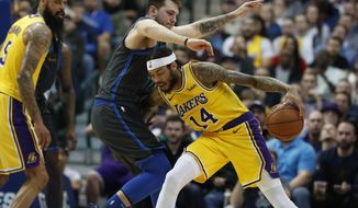 Los Angeles Lakers forward Brandon Ingram (14) drives against Dallas Mavericks forward Luka Doncic (77) of Germany during the the second half of an NBA basketball game in Dallas, Monday, Jan. 7, 2019. (AP Photo/LM Otero)