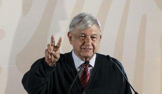 Mexico's President Andres Manuel Lopez Obrador speaks during the presentation of his new economic program for the northern border zone, in Tijuana, Mexico, Sunday, Jan. 6, 2019. (AP Photo/Daniel Ochoa de Olza)
