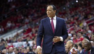 FILE - In this Dec. 28, 2018, file photo,  North Carolina State head coach Kevin Keatts watches the action during the first half of an NCAA college basketball game against Loyola Maryland, in Raleigh, N.C. North Carolina State has thrived with a deep rotation. Keatts isn't hesitating to go 10 deep and the Wolfpack finds themselves ranked in the Top 25. (AP Photo/Ben McKeown, File)