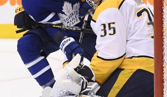 Toronto Maple Leafs right wing Connor Brown (28) is stopped by Nashville Predators goaltender Pekka Rinne (35) during second-period NHL hockey game action in Toronto, Monday, Jan. 7, 2019. (Nathan Denette/The Canadian Press via AP)