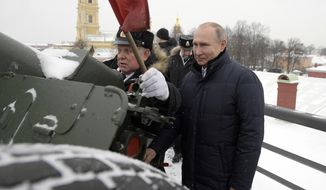 Russian President Vladimir Putin, right, prepares to shoot a fortress cannon, during a traditional midday cannon shot at the Peter and Paul Fortress in St. Petersburg, Russia, Monday, Jan. 7, 2019. (Alexei Druzhinin, Sputnik, Kremlin Pool Photo via AP)