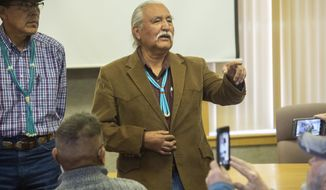 Kenneth Maryboy, left, and Willie Grayeyes thank their supporters after being sworn in to the San Juan County Commission at the San Juan County Courthouse in Monticello, Utah, on Monday, Jan. 7, 2019.  (Rick Egan/The Salt Lake Tribune via AP)