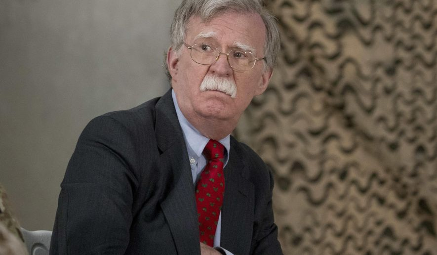 National Security Adviser John Bolton attends a meeting with President Donald Trump and senior military leadership at Al Asad Air Base, Iraq. (AP Photo/Andrew Harnik, File)