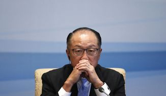 In this Sept. 12, 2017, file photo World Bank President Jim Yong Kim pauses during a joint press conference for the 1+6 Roundtable Dialogue at the Diaoyutai State Guesthouse in Beijing. (AP Photo/Andy Wong, File)