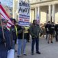 Second Amendment fans protest at the New Hampshire Statehouse in Concord. A firearms ban in the building prompted a GOP uprising. (Associated Press)