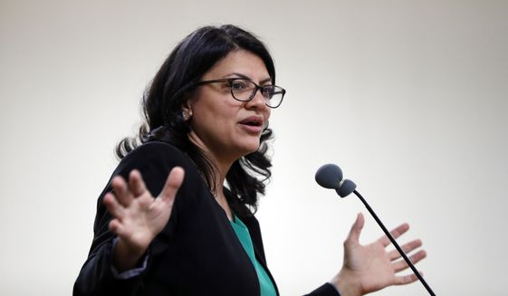 In this photo, Rashida Tlaib, then a Democratic candidate for Michigan's 13th Congressional District, speaks at a rally in Dearborn, Mich., Friday, Oct. 26, 2018. Ms. Tlaib went on to win the race and become one of the two first Muslim women to serve in the U.S. House. (AP Photo/Paul Sancya) **FILE**