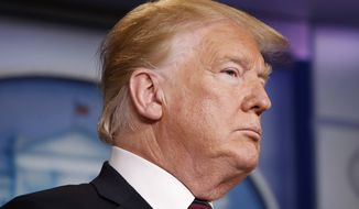 President Donald Trump listens to members of the Border Patrol speak about border security, Thursday Jan. 3, 2019, during a surprise appearance in the briefing room of the White House in Washington. (AP Photo/Jacquelyn Martin)