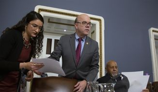 House Rules Committee Chairman Rep. Jim McGovern, D-Mass., joined at right by Rep. Alcee Hastings, D-Fla., opens the first organizational meeting of the panel under the new Democratic majority, at the Capitol in Washington, Tuesday, Jan. 8, 2019. The Rules Committee has significant power to determine which bills will be brought to the floor of the House for consideration and whether amendments will be allowed on a bill when it is debated by the entire House. (AP Photo/J. Scott Applewhite)