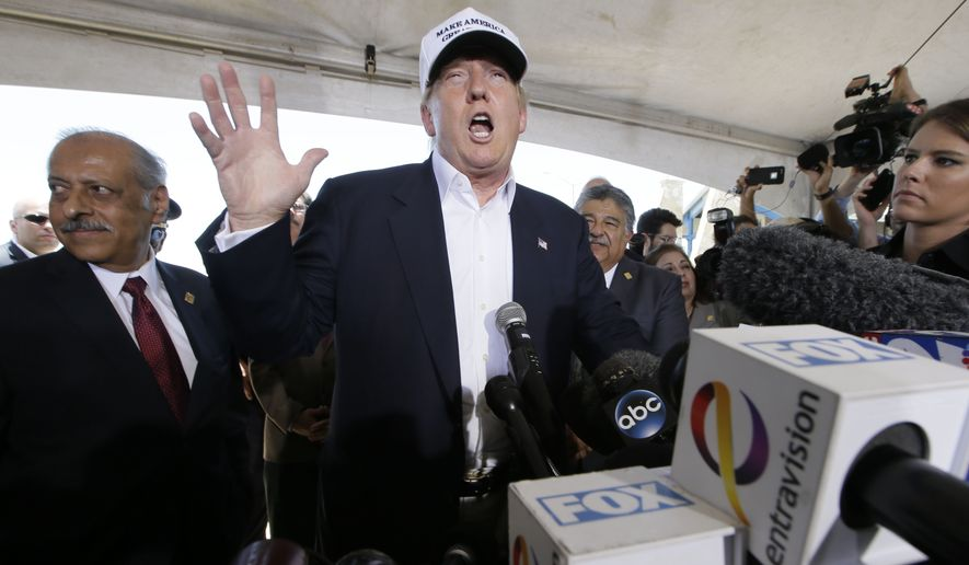 Republican presidential hopeful Donald Trump speaks to the media during a tour of the World Trade International Bridge at  the U.S. Mexico border in Laredo, Texas, Thursday, July 23, 2015. (AP Photo/LM Otero)