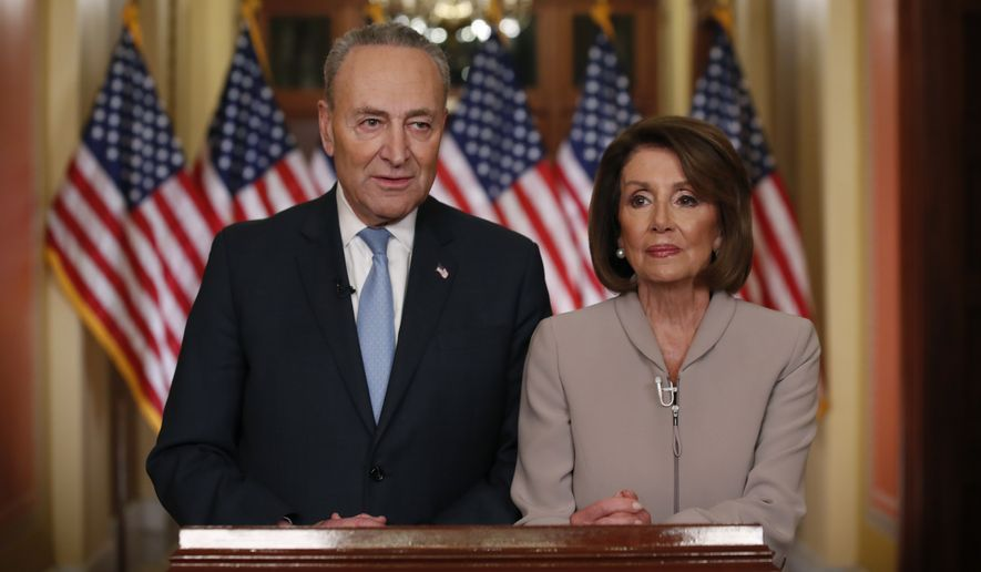 House Speaker Nancy Pelosi of Calif., and Senate Minority Leader Chuck Schumer of N.Y., pose for photographers after speaking on Capitol Hill in response President Donald Trump's prime-time address on border security, Tuesday, Jan. 8, 2019, in Washington. (AP Photo/Alex Brandon)