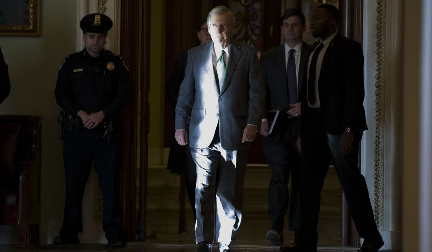 Senate Majority Leader Mitch McConnell of Ky., walks to his office from the Senate floor on Capitol Hill, Tuesday, Jan. 8, 2019 in Washington. (AP Photo/Alex Brandon)