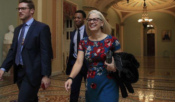 Sen. Kyrsten Sinema, D-Ariz., leaves the Senate floor on Capitol Hill in Washington, Tuesday, Jan. 8, 2019. (AP Photo/Manuel Balce Ceneta)