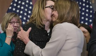 House Speaker Nancy Pelosi of Calif., right, embraces gun violence victim former Rep. Gabby Giffords, during a news conference to announce the introduction of bipartisan legislation to expand background checks for sales and transfers of firearms, on Capitol Hill, Tuesday, Jan. 8, 2019 in Washington. (AP Photo/Alex Brandon)
