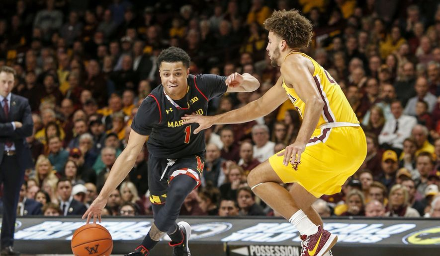 Maryland guard Anthony Cowan Jr. (1) dribbles around Minnesota guard Gabe Kalscheur (22) during an NCAA college basketball game Tuesday, Jan. 8, 2019, in Minneapolis. Maryland won 82-67. (AP Photo/Bruce Kluckhohn)