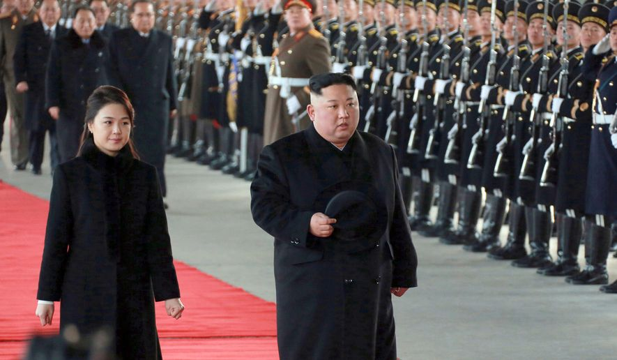 """In this Monday, Jan. 7, 2019, photo provided on Tuesday, Jan. 8, 2019, by the North Korean government, North Korean leader Kim Jong-un walks with his wife Ri Sol-ju at Pyongyang Station in Pyongyang, North Korea, before leaving for China. The content of this image is as provided and cannot be independently verified. Korean language watermark on image as provided by source reads: """"KCNA"""" which is the abbreviation for Korean Central News Agency. (Korean Central News Agency/Korea News Service via AP)"""