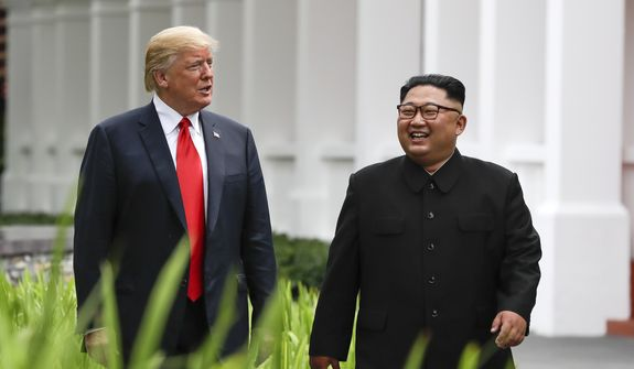 In this June 12, 2018, photo, U.S. President Donald Trump (left) and North Korea leader Kim Jong-un walk from their lunch at the Capella resort on Sentosa Island in Singapore. (Associated Press) **FILE**