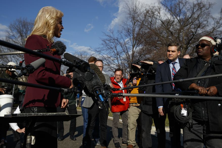 White House senior adviser Kellyanne Conway talks to CNN journalist Jim Acosta during a press gaggle outside the White House, Tuesday, Jan. 8, 2019, in Washington. (AP Photo/ Evan Vucci)