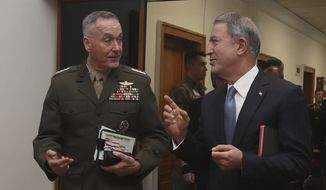 The U.S. chairman of the Joint Chiefs of Staff, Gen. Joseph Dunford, left, and Turkey's Defense Minister Hulusi Akar speak during a meeting, in Ankara, Turkey, Tuesday, Jan. 8, 2019.  (Turkish Defence Ministry via AP)