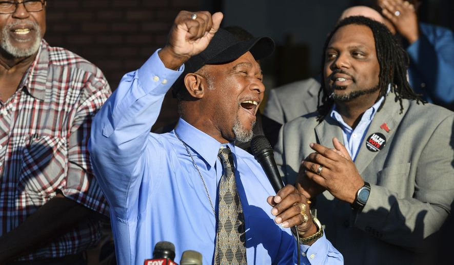 Pastor Wesley Tunstall praises God while addressing media at the Sarasota County Supervisor of Elections Office on Tuesday, Jan. 8, 2019, in Sarasota, Fla. Tunstall, a convicted felon, registered to vote on Tuesday, the first day that Amendment 4, which restores the right to vote for most felons, went into effect.  (Dan Wagner/Sarasota Herald-Tribune via AP)