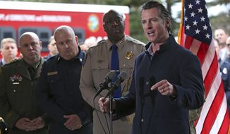 Gov. Gavin Newsom discusses emergency preparedness during a visit to the California Department of Forestry and Fire Protection CalFire Colfax Station Tuesday, Jan. 8, 2019, in Colfax, Calif. On his first full day as governor, Newsom announced executive actions to improve the state's response to wildfires and other emergencies. (AP Photo/Rich Pedroncelli)