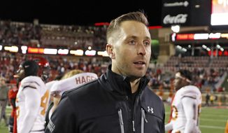 FILE - In this Nov. 10, 2018 file photo Texas Tech coach Kliff Kingsbury walks off the field after the team's NCAA college football game against Texas in Lubbock, Texas. The Arizona Cardinals have hired Kingsbury, a move aimed at providing guidance for young quarterback Josh Rosen and resuscitating the worst offense in the NFL. The Cardinals announced the hiring Tuesday, Jan. 8, 2018 after a long interview earlier in the day. (AP Photo/Brad Tollefson, file) **FILE**