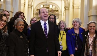 Colorado Gov.-elect Jared Polis jokes with members of the statehouse and Senate before his inauguration at the Colorado State Capitol in Denver on Tuesday, Jan. 8, 2019. (AAron Ontiveroz/The Denver Post via AP)