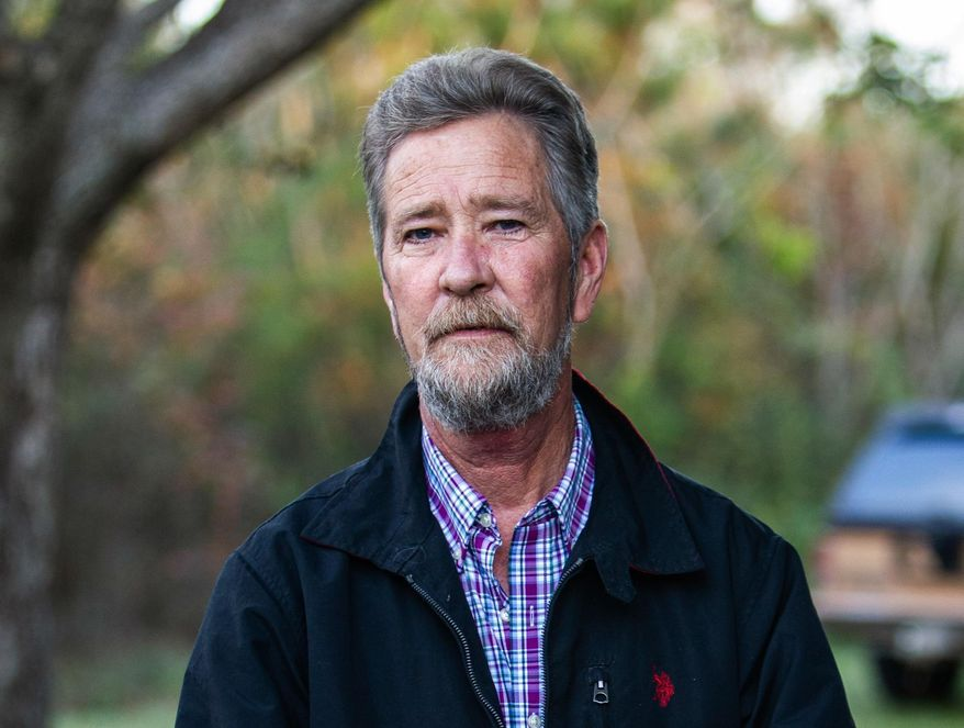 FILE - In this Dec. 5, 2018 photo, Leslie McCrae Dowless Jr. poses for a portrait outside of his home in Bladenboro, N.C. A North Carolina elections investigator spent weeks in 2010 probing whether Dowless, the man at the center of a current scandal, was among a group of local political operatives allegedly buying votes. (Travis Long/The News & Observer via AP, File)