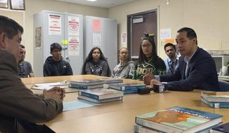 Former Obama housing chief Julian Castro, right, meets with students at Rancho High School in Las Vegas, Tuesday, Jan. 8, 2019. Castro has met with Nevada Democrats and leaders of the Latino community in Las Vegas days ahead of his planned announcement of a 2020 run for the presidency. (AP Photo/Michelle L. Price)