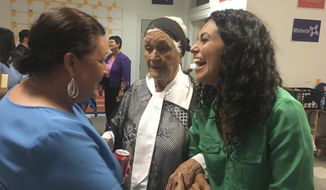 FILE - In this Oct. 3, 2018 file photo, Democrat Xochitl Torres Small, right, greets supporters at the opening of her Sunland Park, New Mexico office during her successful campaign for a U.S. House seat in southern New Mexico. Republican Yvette Herrell, who lost to Torres Small in a close election, announced Tuesday, Jan. 8, 2019, she will challenge Torres Small again in 2020. (AP Photo/Russell Contreras, File)